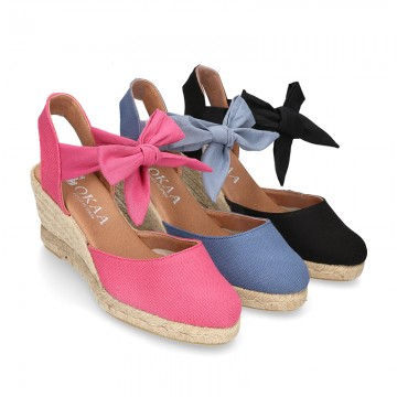Wedge canvas sandal espadrille with buckle fastening in washing effect.