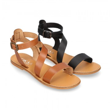 Cowhide leather girl sandal shoes and with buckle closure to the ankle.