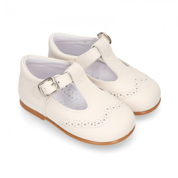 Nappa leather Little Classic T-Strap style shoes with perforated design.