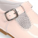 Patent leather little T-Strap shoes with buckle fastening in PASTEL colors.