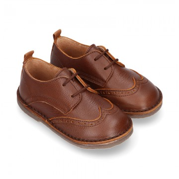 Nappa leather kids Laces up shoes with perforated design.