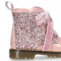 ROCK style patent leather kids boots with GLITTER and velvet ties closure.