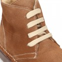 Suede leather kids ankle boots with fake hair lined.