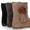 Classic kids suede leather boots with FAKE HAIR POMPONS design.