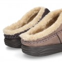 Home shoes with clog design and wool lining for large sizes.