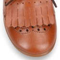 Laces up Oxford kids shoes with fringed tongue in TAN leather.