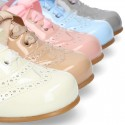 Classic Patent leather Laces up shoes in soft colors.