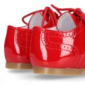 Classic English style shoes in RED patent leather.