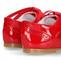 Classic Laces up shoes in red patent leather.