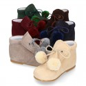 Classic suede leather ankle boots with POMPONS.