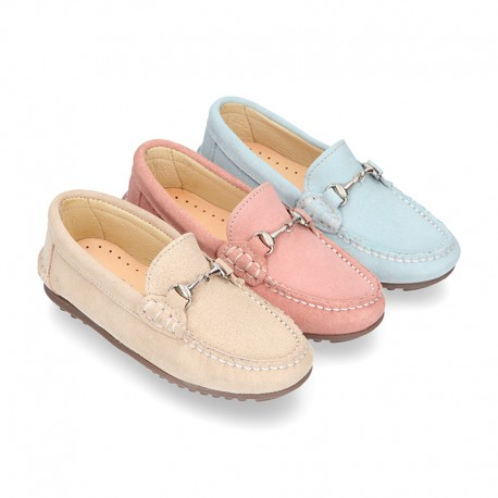 New Moccasin shoes with stirrup in pastel colors.