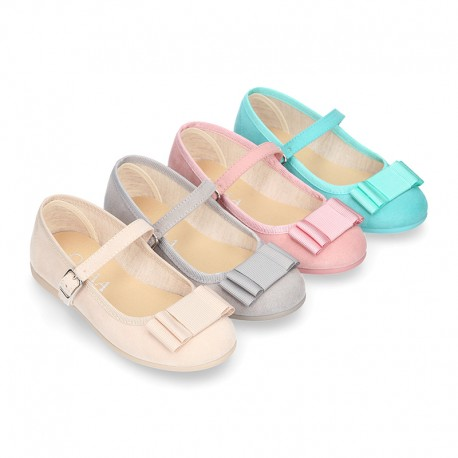 Spring summer canvas little Mary Janes with shoemaker bow in pastel colors.