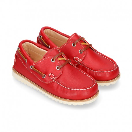 Classic kids leather Boat shoes with shoelaces and spring summer soles.