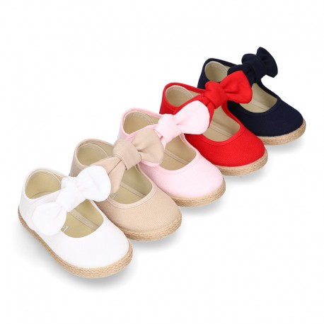 Cotton canvas espadrille shoes little Mary Jane style with hook and loop strap and bow.