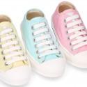 Zapatilla niños CASUAL con puntera y cordones en colores pasteles.