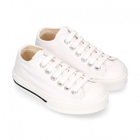 White Cotton canvas OKAA Sneaker shoes with shoelaces and toe cap.