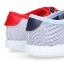 Combined Cotton canvas tennis shoes with ties closure.