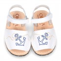 Embroidery leather Menorquina sandals with hook and loop strap.
