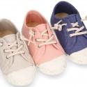 Zapatilla niño con puntera y cordones elásticos en lona algodón RECICLADO en colores suaves.