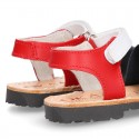 New Menorquina sandals with hook and loop strap in three colors.