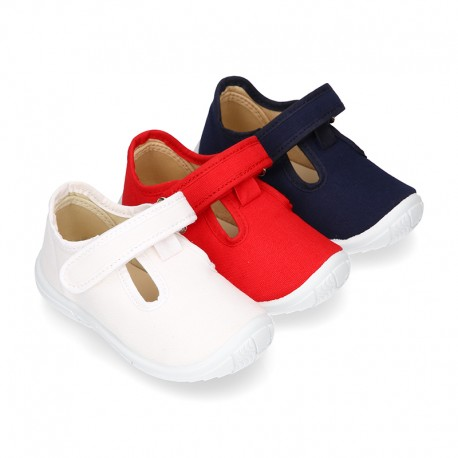 Cotton canvas kids T-Bar sandal shoes with hook and loop strap closure.