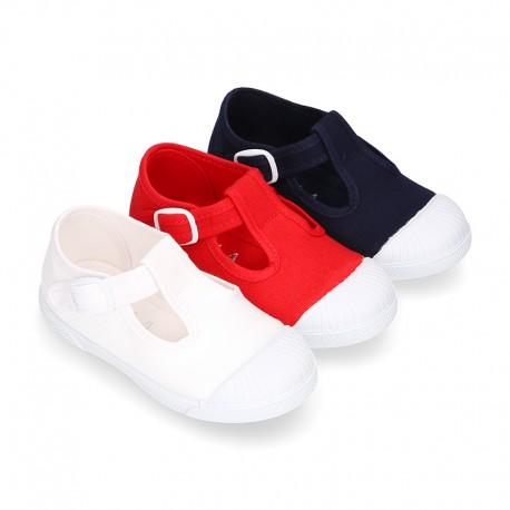Cotton canvas Kids T-Strap shoes with toe cap.