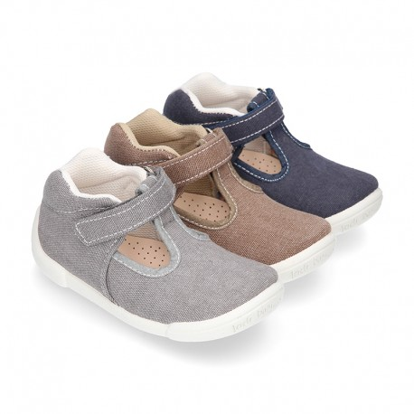 Cotton canvas Kids T-Strap shoes with hook and loop closure, counter and toe cap.