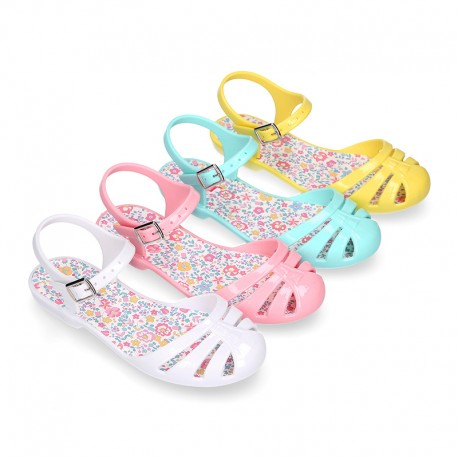 Girl Jelly ballet style shoes with buckle fastening and FLOWERS design for beach and pool use.