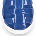 Tennis style kids jelly shoes with button and clip closure for Beach and Pool.
