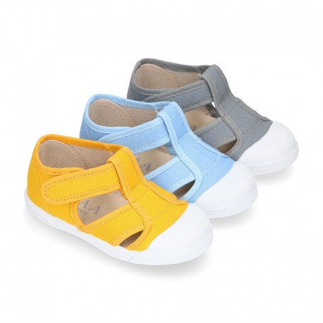 Organic Cotton canvas Kids Sandal shoes with hook and loop strap closure and toe cap.