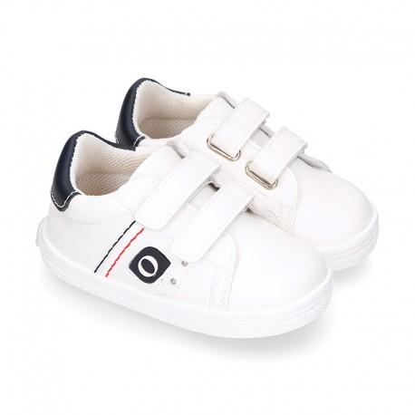 White color OKAA FLEX tennis kids shoes laceless.