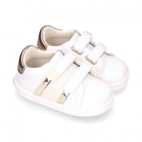 White color OKAA FLEX girl tennis shoes laceless with stripes design.