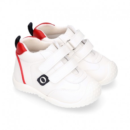 White color OKAA FLEX tennis kids shoes laceless and with toe cap.