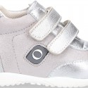 Silver color OKAA FLEX tennis girl shoes laceless and with toe cap.