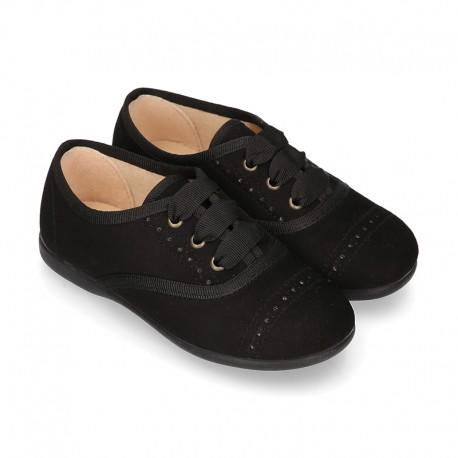 Zapato tipo BLUCHER niños en Serratex NEGRO con picados.