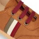 Zapatilla o Tenis niño en Serratex con cordones en colores de moda.