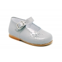Classic patent leather little Mary Jane shoes with flower detail.