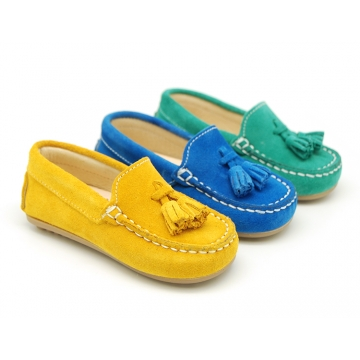 Suede leather Moccasin shoes with tassels in seasonal colors for little boys.
