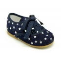 Suede leather laces up shoes with stars print design.