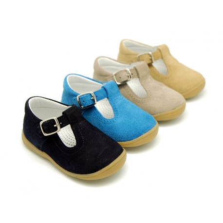 Classic suede leather T-strap shoes with toe cap and buckle fastening.