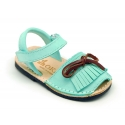 Nubuck leather Menorquina sandal shoes with velcro strap and fringed design.