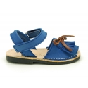 Nubuck leather Menorquina sandal shoes with hook and loop strap and fringed design.