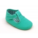 Cotton canvas T-strap shoes with hook and loop strap for babies.