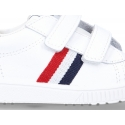 New Washable leather tennis shoes with velcro strap and flag design.