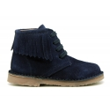 Suede leather ankle desert boots style with fringed design.