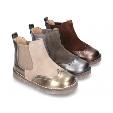 Combined leather kids ankle boots with elastic band and thick outsole.