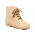 Classic Pascuala style ankle boots in patent leather in soft colors.