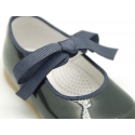 Patent leather little Mary Janes with ties closure.