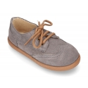New Laces up shoes with removal tongue with fringed design in suede leather.