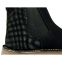 Suede leather ankle boots with metallic dots counter.